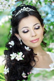 Beautiful bride in a blossoming garden. The image of a beautiful bride in a blossoming garden Royalty Free Stock Photos