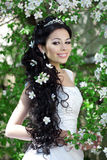 Beautiful bride in a blossoming garden Stock Photos