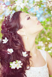 Beautiful bride in a blossoming garden Stock Photos