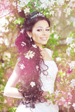 Beautiful bride in a blossoming garden Stock Photo