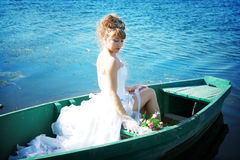 Beautiful bride in the boat Royalty Free Stock Photos