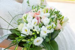 Beautiful bride with bouqet. Of summer flowers. Love story, marrige stock photos