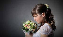Beautiful bride with bouquet Royalty Free Stock Image
