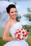 Beautiful bride with bouquet Stock Photos