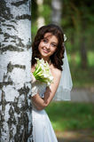 Beautiful bride with bouquet Stock Image