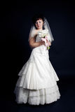 Beautiful bride with a bouquet on a black backgrou Stock Image