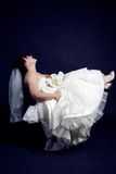 Beautiful bride with a bouquet a black background Royalty Free Stock Photography