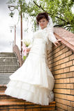 Beautiful bride with a bouquet, brick wall Royalty Free Stock Images