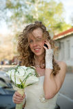 Beautiful bride with a bouquet of calla lilies Stock Photo