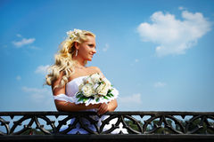 Beautiful bride with bouquet of flower near lake Stock Images