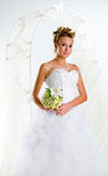 Beautiful bride with bouquet of flowers Stock Photos