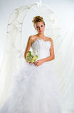 Beautiful bride with bouquet of flowers Stock Photo