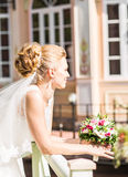 Beautiful bride with bouquet of flowers outdoor Stock Images