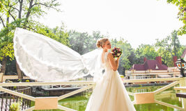 Beautiful bride with bouquet of flowers outdoor Royalty Free Stock Photo