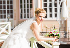 Beautiful bride with bouquet of flowers outdoor Stock Image