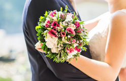 Beautiful bride with bouquet of flowers outdoor Stock Photos