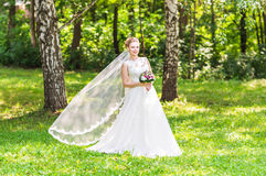 Beautiful bride with bouquet of flowers outdoor Royalty Free Stock Images