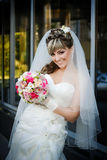 Beautiful bride with a bouquet of flowers Royalty Free Stock Photography