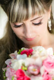 Beautiful bride with a bouquet of flowers Royalty Free Stock Photo