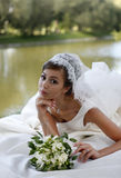 Beautiful bride. The beautiful bride with bouquet in park Royalty Free Stock Photos