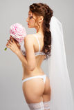 Beautiful bride with bouquet of peonies Stock Photography