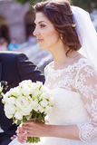 Beautiful bride  with bouquet from white roses Stock Photography