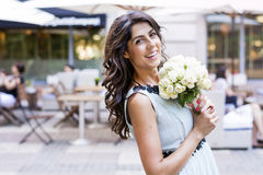 Beautiful bride  with bouquet of  white roses Stock Photo