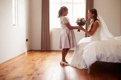 Beautiful Bride With Bridesmaid In Bedroom Royalty Free Stock Photography