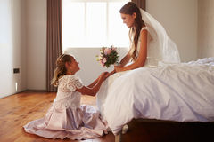 Beautiful Bride With Bridesmaid In Bedroom Stock Photography