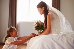 Beautiful Bride With Bridesmaid In Bedroom Stock Photos