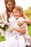 Beautiful Bride With Bridesmaid Outdoors Stock Photo