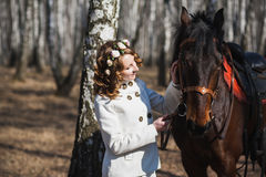 Beautiful bride with brown horse Royalty Free Stock Photography