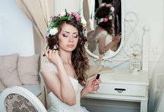Beautiful bride brunette with  makeup. Beautiful bride brunette in white wedding dress with hairstyle and bright makeup Stock Image