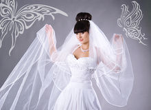Beautiful bride and with butterflies royalty free stock images