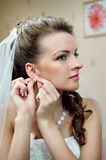 Beautiful bride buttons earrings Royalty Free Stock Images