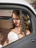 Beautiful bride in the car Royalty Free Stock Photo
