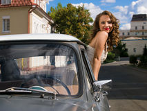 Beautiful bride in the car Royalty Free Stock Photos