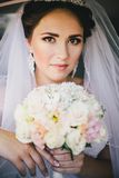 Beautiful bride in a car Royalty Free Stock Images