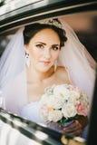 Beautiful bride in a car Stock Photos