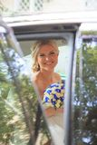 Beautiful bride in car. Wedding Day stock photo