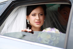 Beautiful bride in car Royalty Free Stock Images