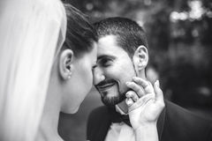 Beautiful bride caress gently, the groom's face Stock Image
