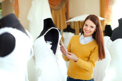 Beautiful bride chooses outfit Stock Photography