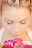 Beautiful Bride close-up. Close-up of a beautiful bride looking down at her bouquet focus on eyelashes royalty free stock photography