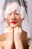 Beautiful bride. The bride closes her eyes and expect embrasing new life after she opens stock image