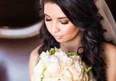 Beautiful bride closeup portrait. With wedding bouquet Royalty Free Stock Photos