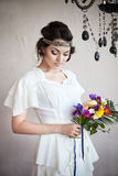 Beautiful bride with colorful wedding bouquet Stock Photos