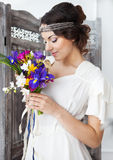 Beautiful bride with colorful wedding bouquet in her hands. Beautiful smiling bride with colorful wedding bouquet in her hands Stock Image