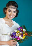 Beautiful bride with colorful wedding bouquet in her hands. Beautiful smiling bride with colorful wedding bouquet in her hands Royalty Free Stock Images