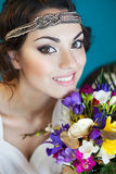 Beautiful bride with colorful wedding bouquet in her hands. Beautiful smiling bride with colorful wedding bouquet in her hands Royalty Free Stock Photography